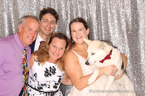 Bride and groom with family and pet, having fun with the classy photo booth at their wedding in Fort Lauderdale, Broward County, Florida
