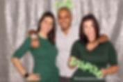 coworkers celebrating company anniversary with inspiring props at corporate photo booth in Boca Raton, Palm Beach County, South Florida