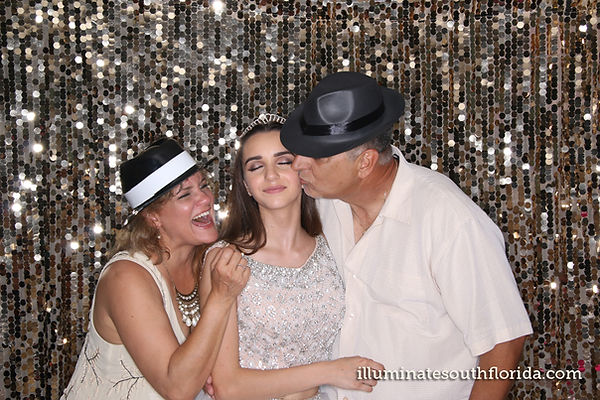 Parents enjoy the photo booth entertainment during quinceañera - in Weston, Broward County - ILLUMINATE South Florida Photo Booth