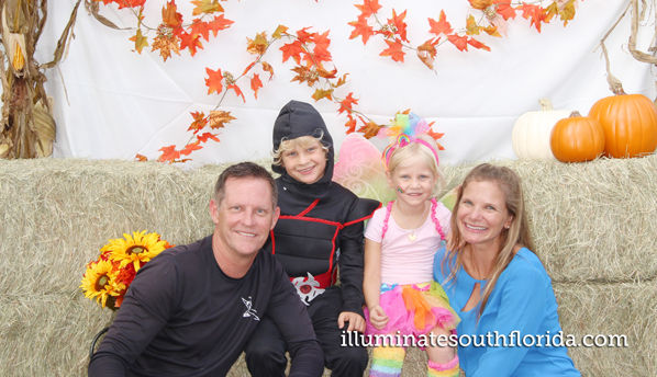 Family photo for the pastor wat fall festival in Fort Lauderdale, Broward County.  Photo Booth provided by ILLUMINATE South Florida - branded marketing anfor corporate sponsor Ed Morse
