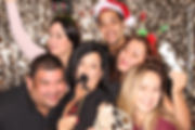 Coworkers and residents of building holiday party photo booth in Miami, Dade County, South Florida.  Each one got a branded photo gift.