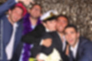 Groomsmen celebrating with the photo booth  at Jewish wedding reception in Miami Dade County