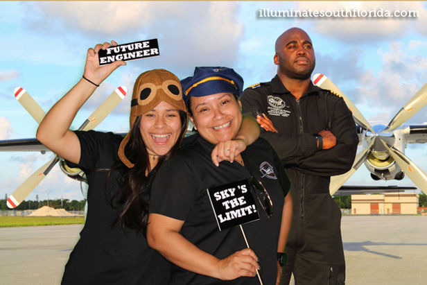 Students and employees pose with Captain Barrington Irving in Broward County Public Schools sponsored greenscreen photo booth at non-profit event STEMFest in Fort Lauderdale