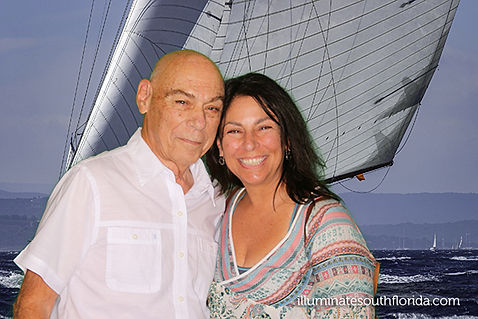 Father and daughter celebrating 85th birthday in Deerfield Beach, Broward County, South Florida with a greenscreen photo booth using a sailboat image for themed party.