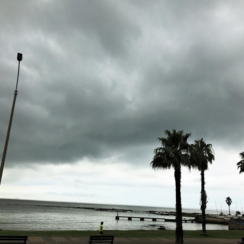Beachside, overhanging rain clouds