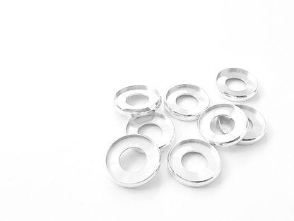 Aluminium binding discs on a white background