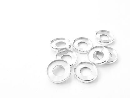 Aluminium binding discs on a white background