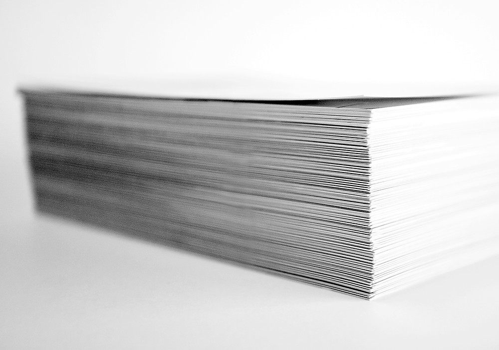 Photograph by Ron Dyar of a block of white paper with white background