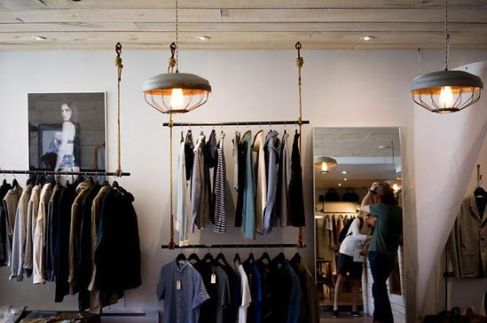 Industrial look and feel cloth shop design, we applied warehouse lighting and timber feature ceiling here.