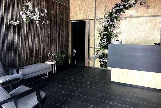 This day spa design, 0813 Studio commercial interior designs presented a balanced design between the hard and cold floor tiles with soft and warm bamboo feature walls.