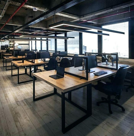modern office design, with opening ceiling, special lighting design and careful selection of workstation and other office furniture with ergonomic features.