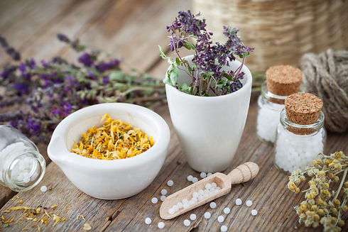 Mortar and bowl of dried healing herbs a