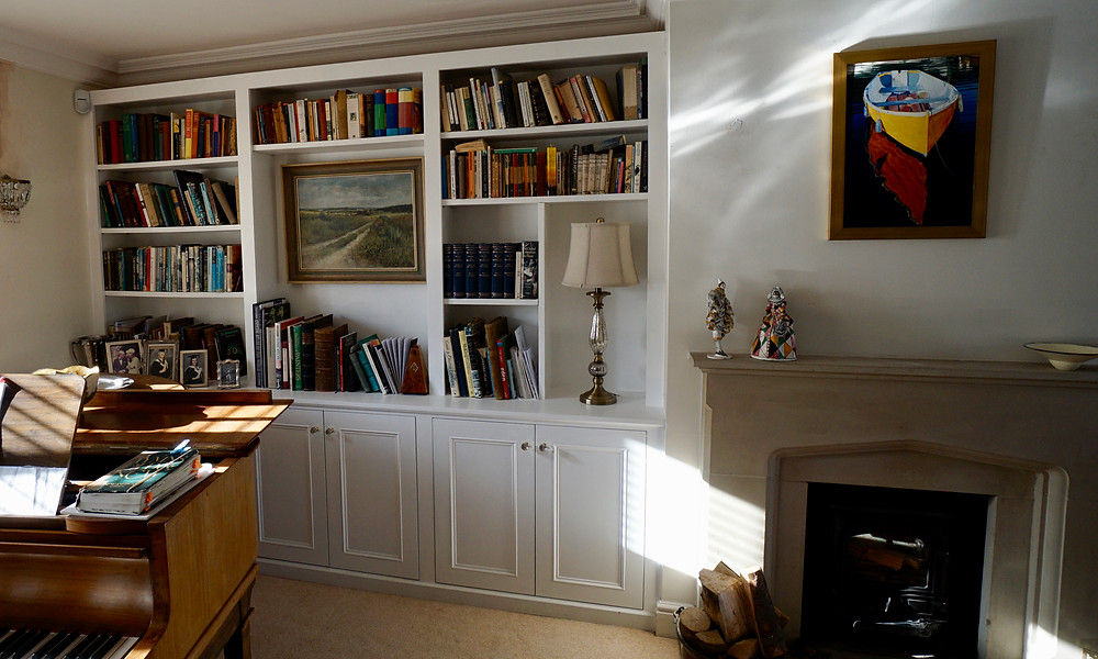 Bespoke book shelving with low level cupboards fitted in Oxford.
