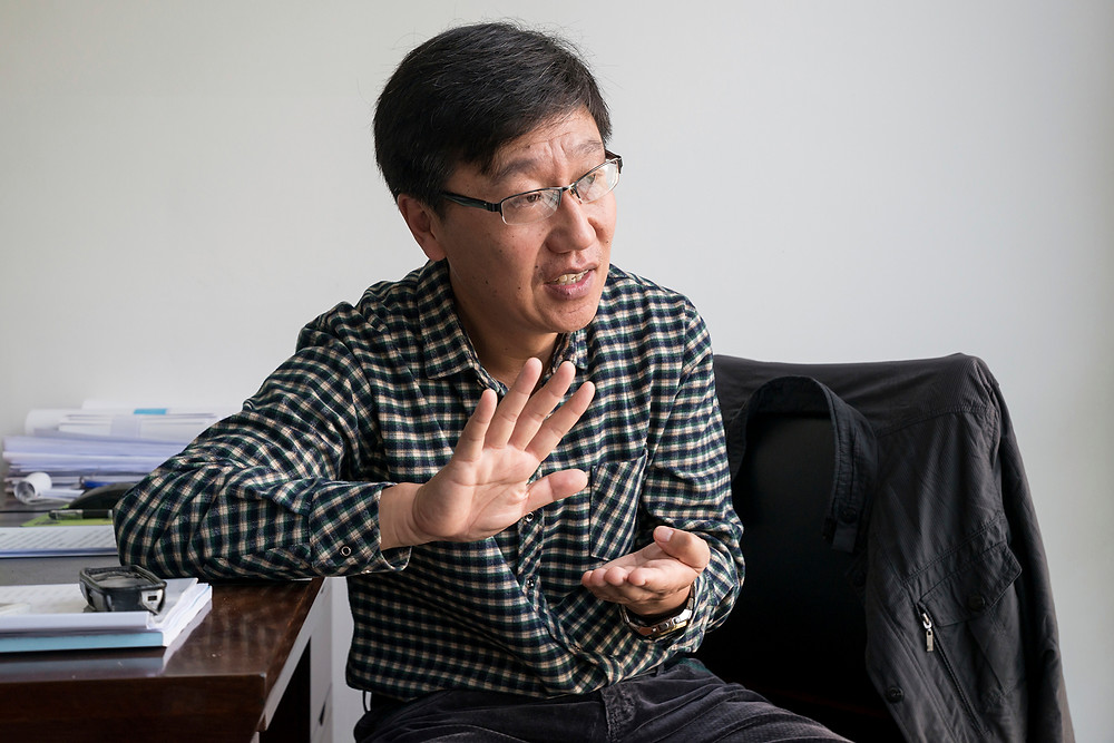 He Junning, deputy director of the Rongcheng Social Credit Management Office, explains how citizens get rewarded for responsible behavior and penalized for breaking the rules in Nov. 2017. (Aurelien Foucault/Picture-Alliance/DPA/AP)