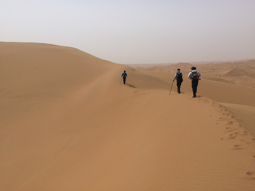 Hikers trek through the Tengger Desert, Inner Mongolia. Photo: Simina Mistreanu