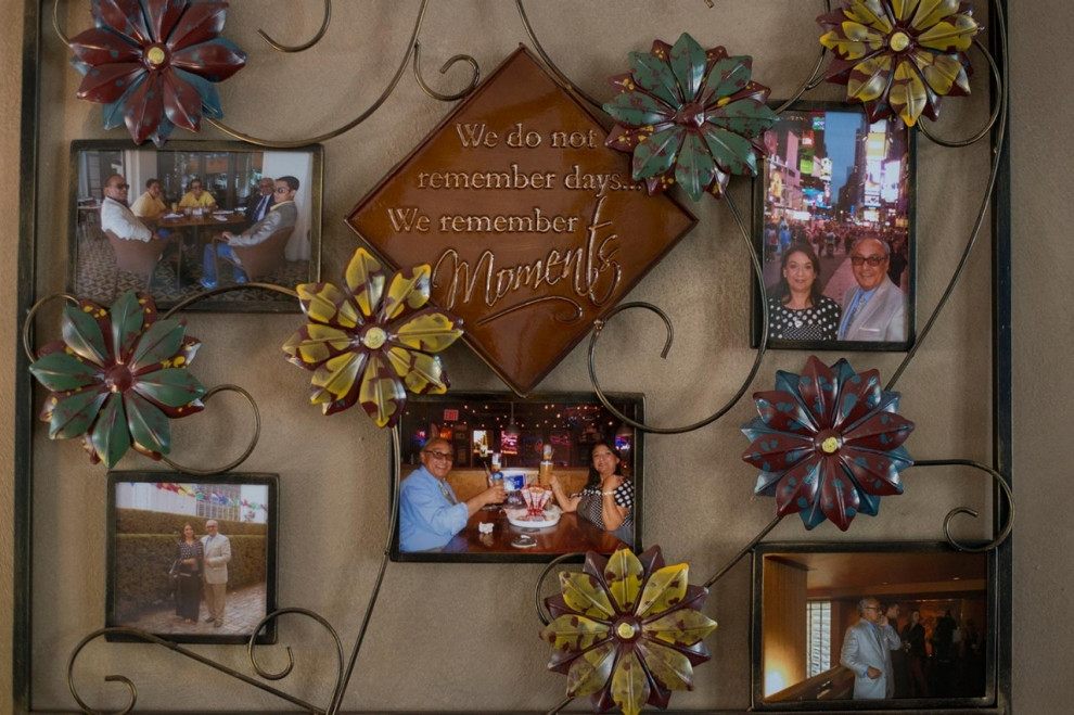 Photographs of the Marks family hang in the dining room of their home. Roxana Pop for Al Jazeera America