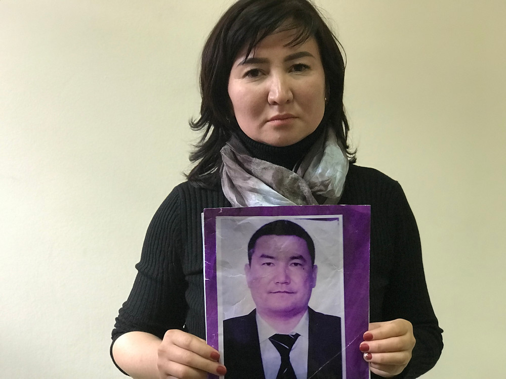Asel Alymkulova holds a picture of her life partner, Doletkhan Shairbek, an energy executive from Kyrgyzstan who is being detained in a Chinese internment camp. @Simina Mistreanu/dpa