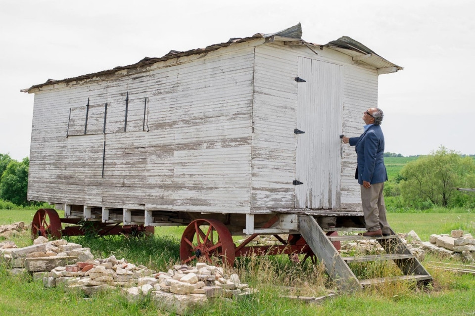 Michael Marks opens the door of an old Roma caravan dating to the early 1900s that sits for sale in the Kansas countryside. He dreams of buying it to display in a future Roma museum he wants to open.Roxana Pop for Al Jazeera America