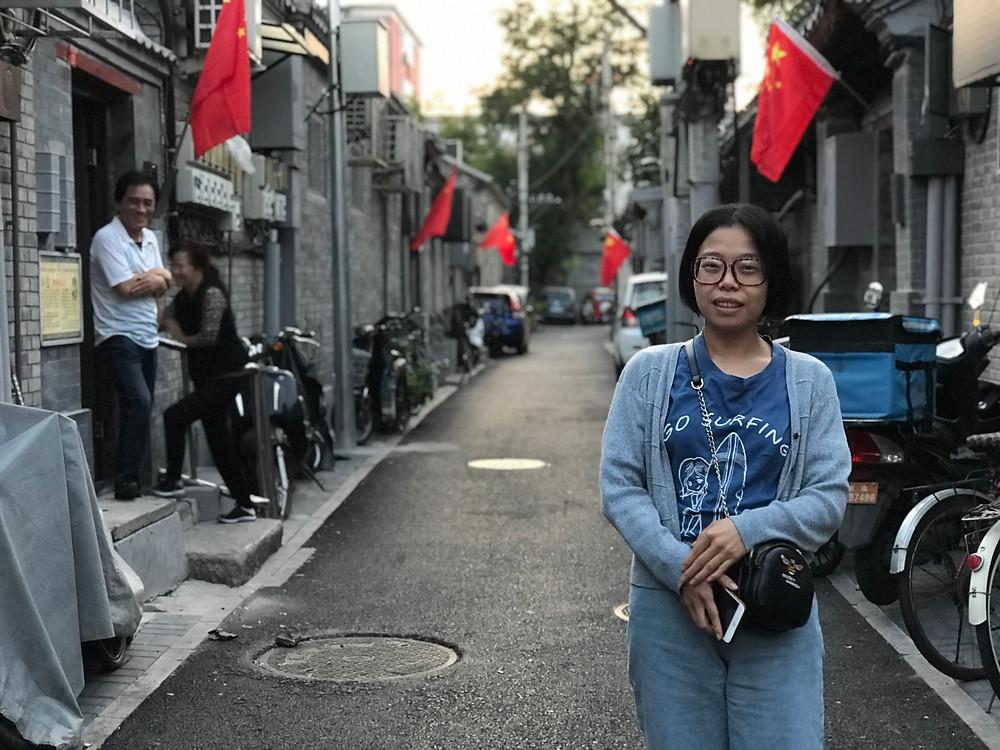 Wu Xiaoliang, 32, is looking forward to watching China's upcoming military parade on TV. [Simina Mistreanu/Al Jazeera]