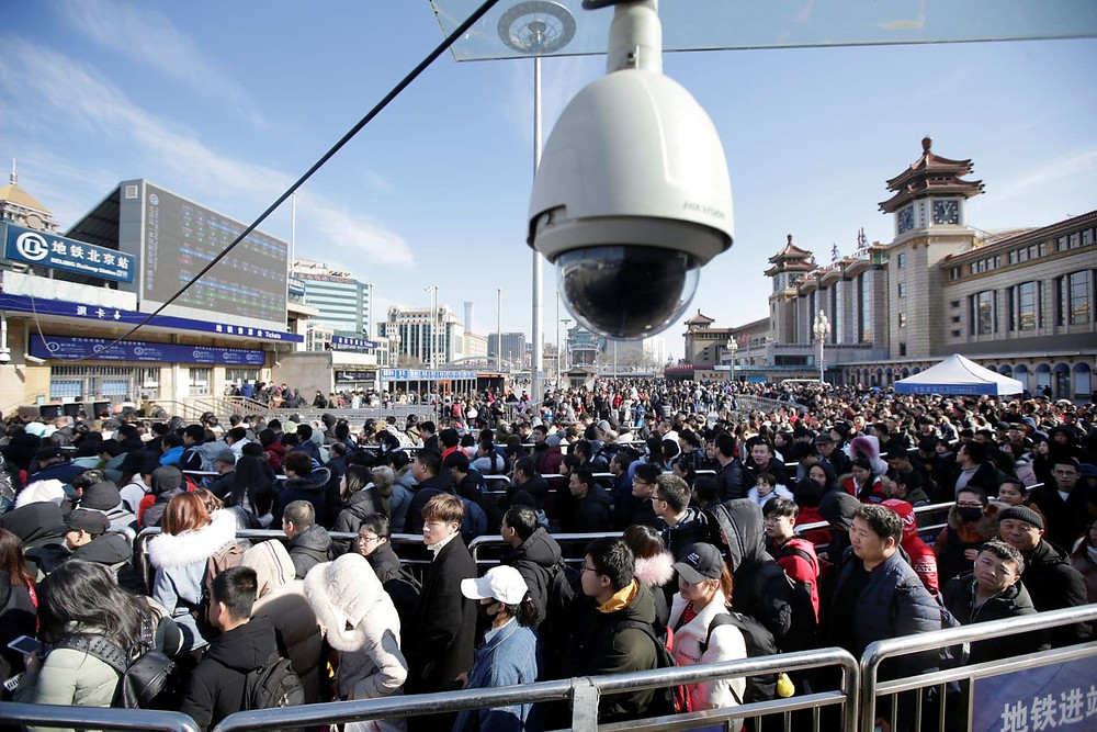 Passengers wait to enter a subway outside Beijing Railway Station during the Chinese LunarNew Year holiday travel rush. (Jason Lee/Reuters)