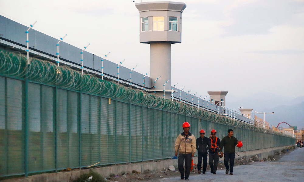 A re-education camp in Xinjiang, part of a network of control and surveillance used against Muslims which also includes an app to track suspicious 'person types'. Photograph: Thomas Peter/Reuters