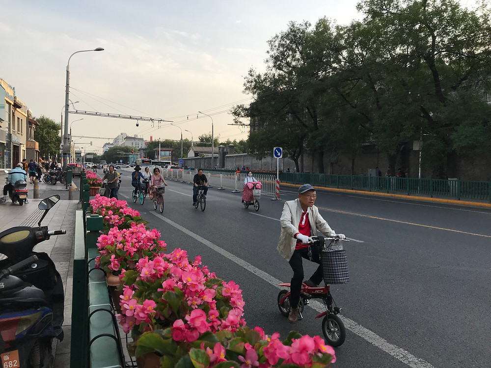Some boulevards in central Beijing have been decorated with flowers before the 70th anniversary of Communist rule.[Simina Mistreanu/Al Jazeera]