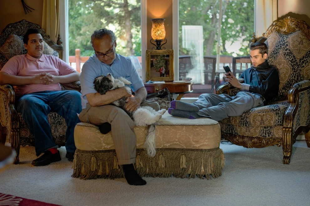 Michael Marks, center, plays with his dog Panda beside his grandsons Jake Marks, left, and Patrick Costello. Roxana Pop for Al Jazeera America