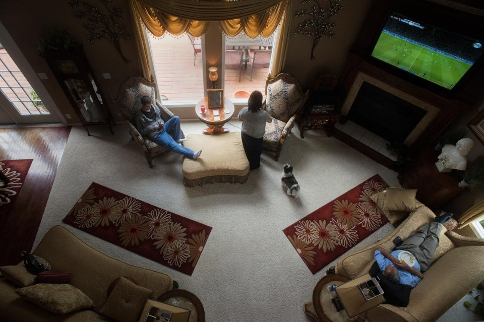 The Marks family watches a Champions League soccer final at home. Roxana Pop for Al Jazeera America