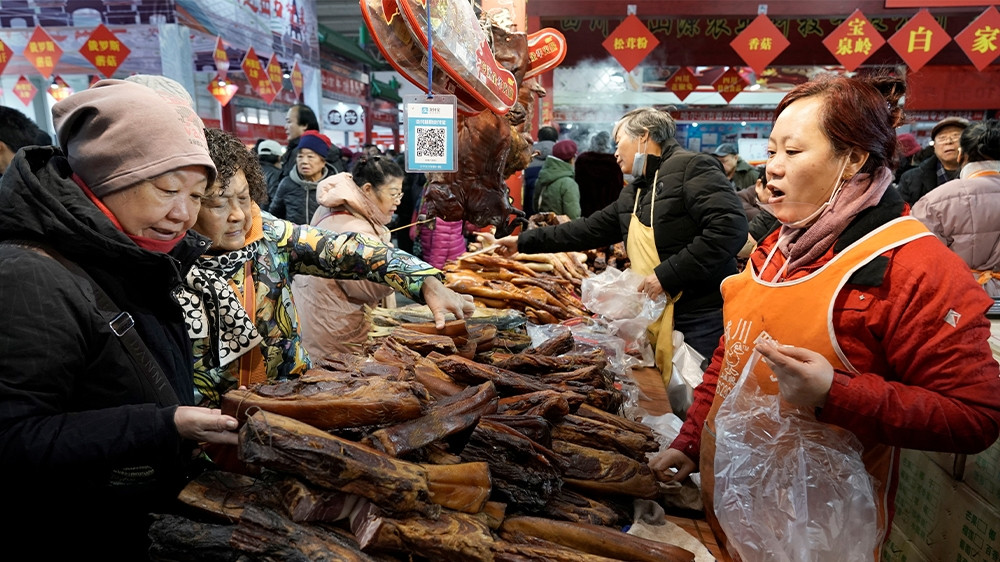 Despite the surge in pork prices, the meat remains a key ingredient for the celebratory dinner on the eve of Lunar New Year [Jason Lee/Reuters]