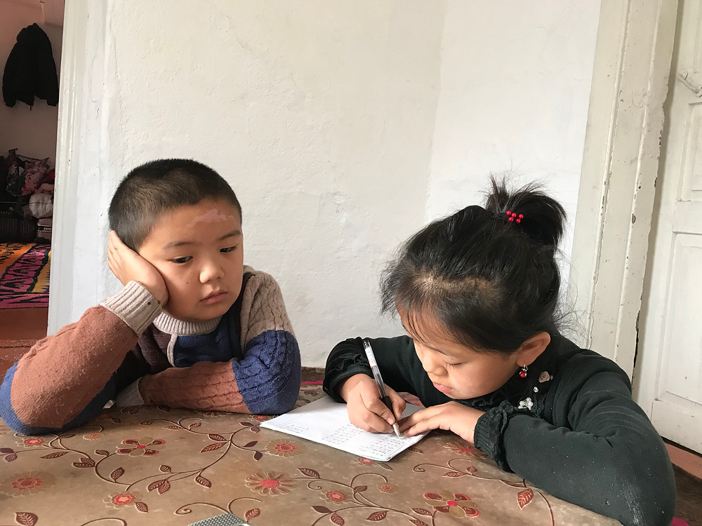 Uligman Bakhitnur, 7, burned his forehead one night when he and his siblings were left unsupervised at home. His mother is being trapped in China. @Simina Mistreanu/dpa