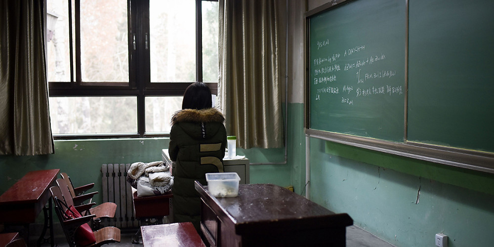 A female student in a classroom on Jan. 17, 2018, at Beijing's Beihang University, which stripped a professor of his position as vice director of the graduate school after an investigation established he had sexually harassed multiple students. The hashtags #MeToo and #MeTooInChina quickly became trending topics on Weibo, with many others speaking about their assaults in the forums. (Wang Zhao/AFP/Getty Images)