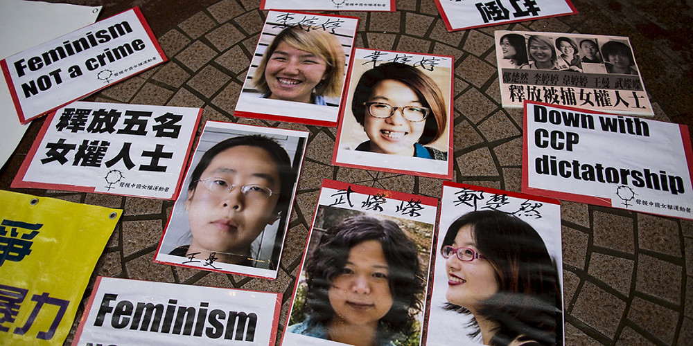 Portraits of Li Tingting, Wei Tingting, Wang Man, Wu Rongrong, and Zheng Churan—who became known as the Feminist Five—during a protest calling for their release in Hong Kong on April 11, 2015. (Tyrone Siu)