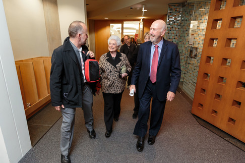 Barbara and Richard Franke, with Christopher Wild, cross from the symposium venue to the Franke Institute for the reception.