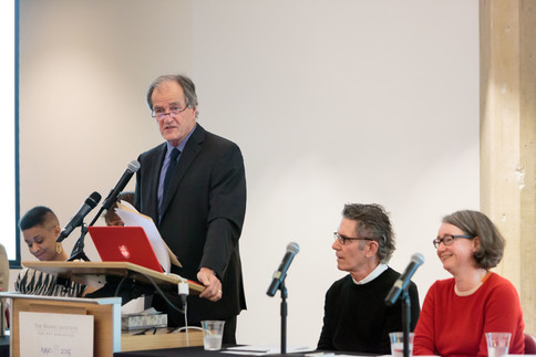 James Chandler introduces the symposium's topics.
