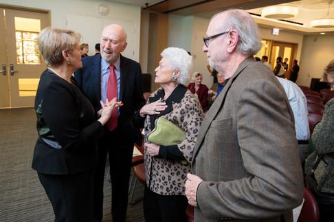 Martha Roth, Richard Franke, Barbara Franke, and Tom Mitchell discuss the event.