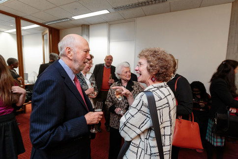 Richard Franke greets Kineret Jaffe at the reception.