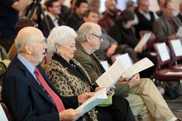 During introductions about the panelists, Richard Franke, Barbara Franke, and Tom Mitchell review the symposium's program.