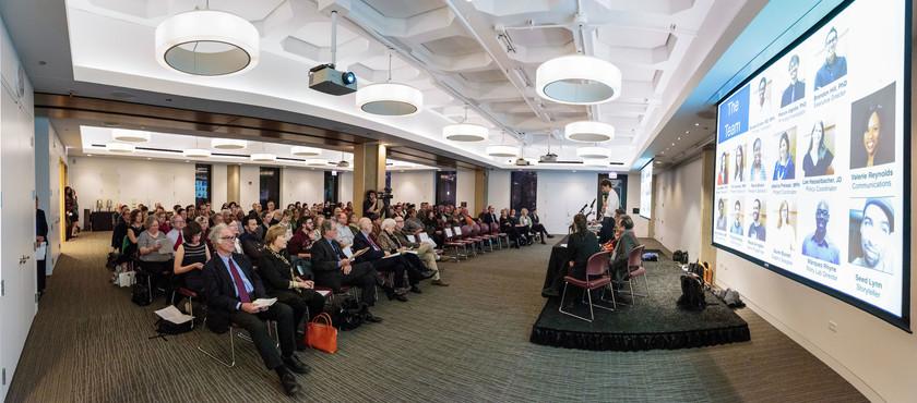 The audience views Patrick Jagoda's slides for his talk.