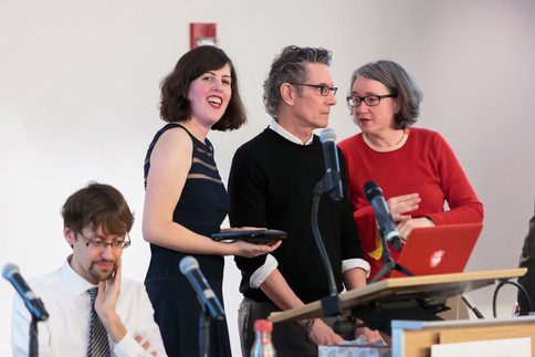 Patrick Jagoda, Bill Brown, and Christine Mehring prepare for their presentations, with Mai Vukcevich.