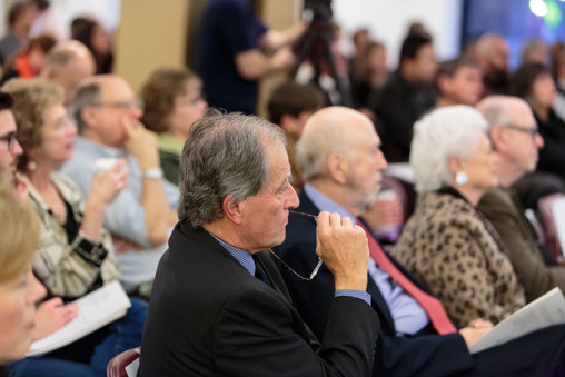 "James Chandler, Richard Franke, and Barbara Franke listen to the panel on ""Integrating the Arts."""