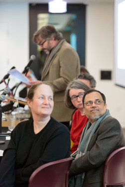 Alison Winter, Dipesh Chakrabarty, and Christine Mehring view Steven Rings' slides for his talk.