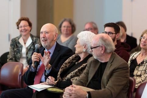 Richard Franke asks the panelists a question.