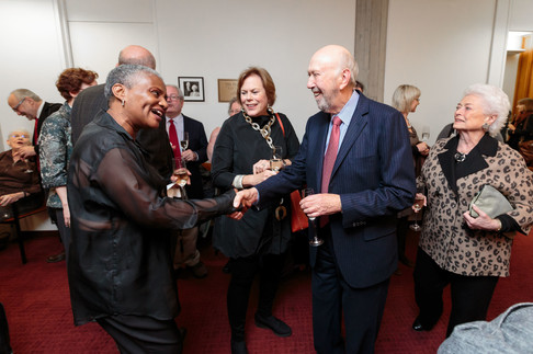 Richard Franke greets Harriette Moody at the reception.