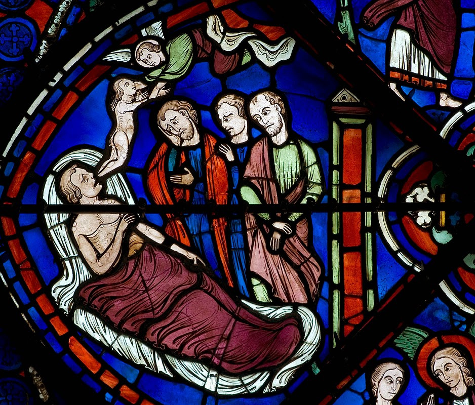 The soul of Gad, a prince of India, leaving his body as he dies.  From a stained-glass window at Chartres cathedral, c. 1220-30.