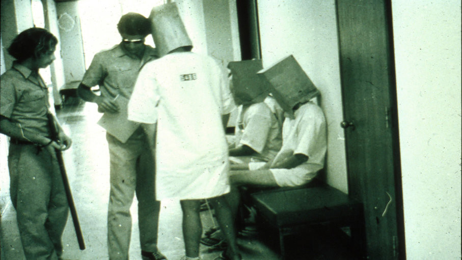 The prisoners heads were covered in paper bags so that they didn't know they were in just a psych building at Stanford.