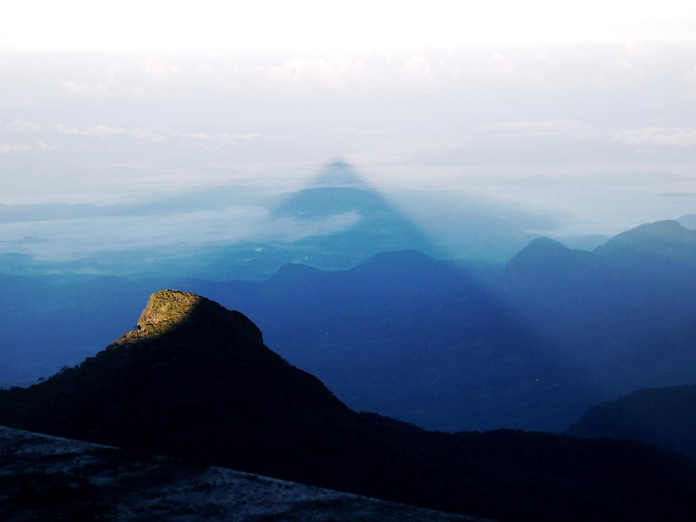 The perfect triangular shadow casted by Adam's Peak