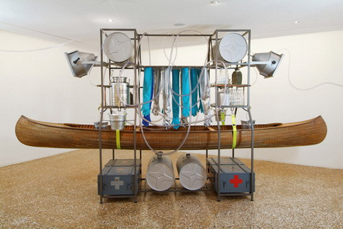 Orta Water — Fluviale intervention unit, 2005 Canadian maple wood canoe, iron structure, water network, gloves, 4 buckets, 4 crates, 4 water drums, 2 water tanks, taps, itunes player, speakers, 24 OrtaWater bottles, 4 flasks, 260 × 510 × 120 cm   46/54