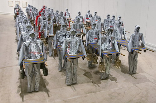 Urban Life Guard N.I.O. 0317, 2005 23 Military Stretcher beds, aluminium coated polyamide, surplus linen, silkscreen print, webbing, clips, wooden head supports, installation dimensions approximately 6 × 25 meters   48/54