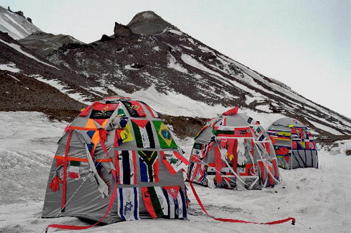 Antarctic Village — No Borders, 2007, ephemeral installation in Antarctica, 2007, 50 dome dwellings: hand stitched with nation flags, fragments of clothing, webbing, silkscreen print dimensions variable 2007 Biennial al Fin del Mundo   27/54