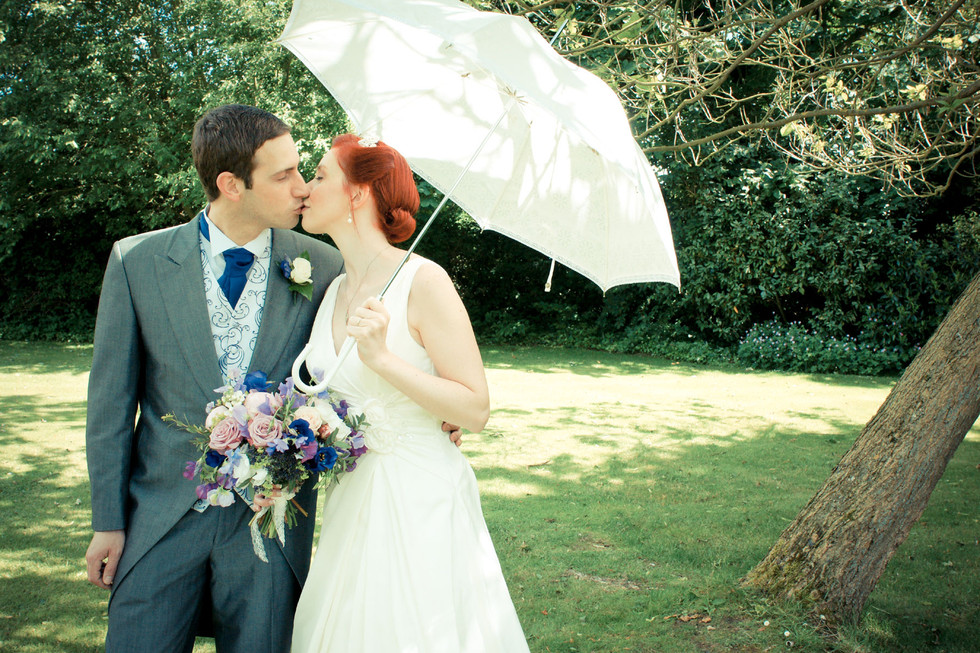 Bride and Groom under a Sun Umbrella